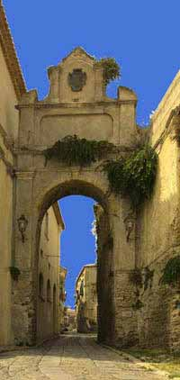 arch over street in Gerace, Italy
