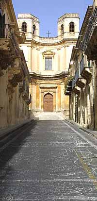 Looking down Via Noccolaci at the Chiesa di Montevergini in Noto, Sicily